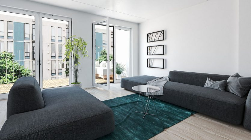 67510478 - large 3d rendered modern luxury condo living room interior with grey upholstered couches and glass doors leading to an outdoor patio overlooking apartment blocks